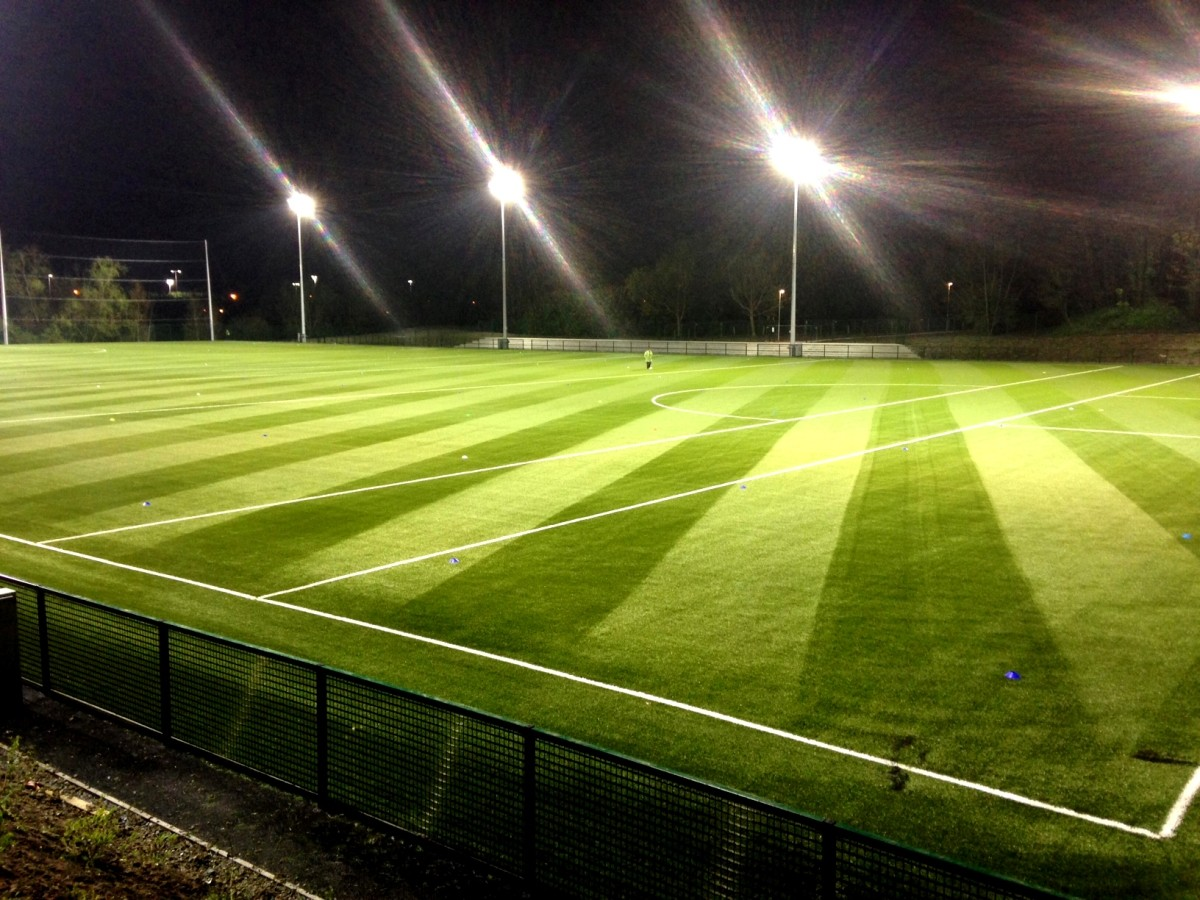 Exterior image of football pitch at night with lighting