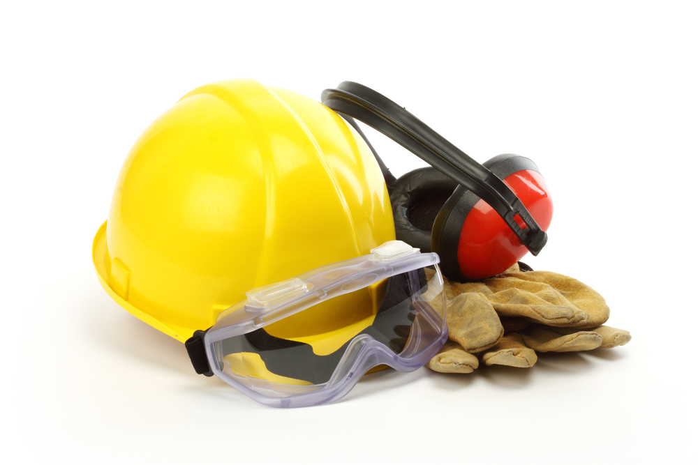 Image of yellow hard hat, ear protectors, safety goggles and heavy duty work gloves