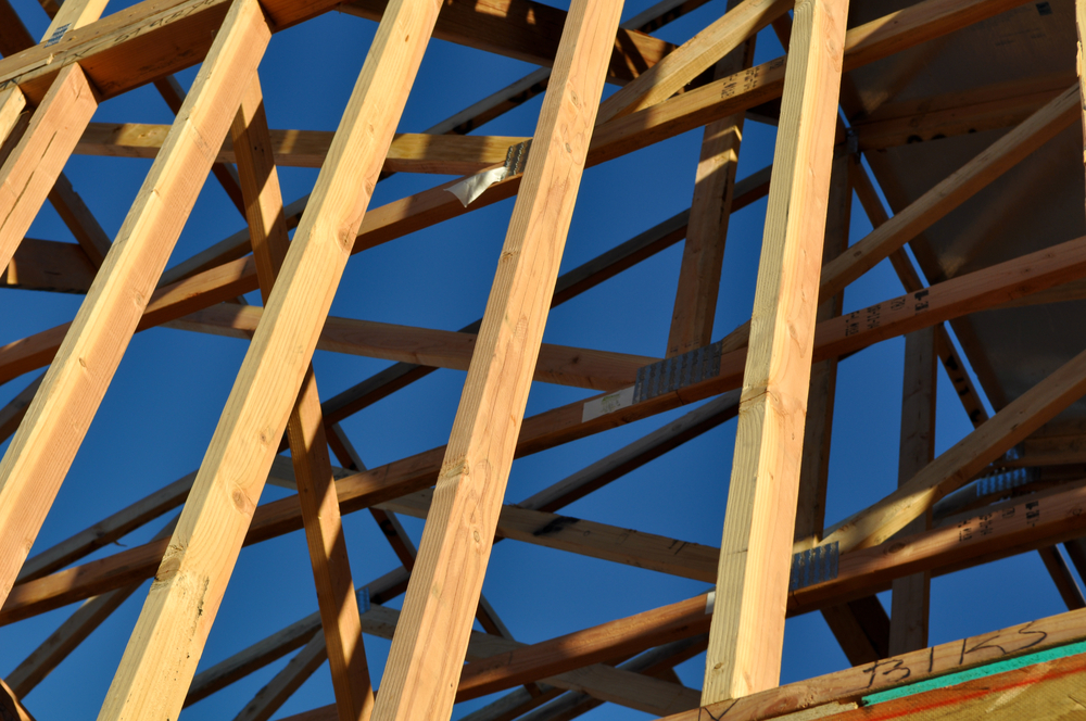 Image of wood scaffolding against blue sky