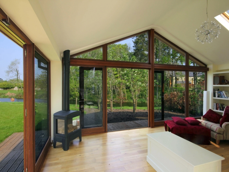Interior image of garden sunroom extension with views of the garden and pond