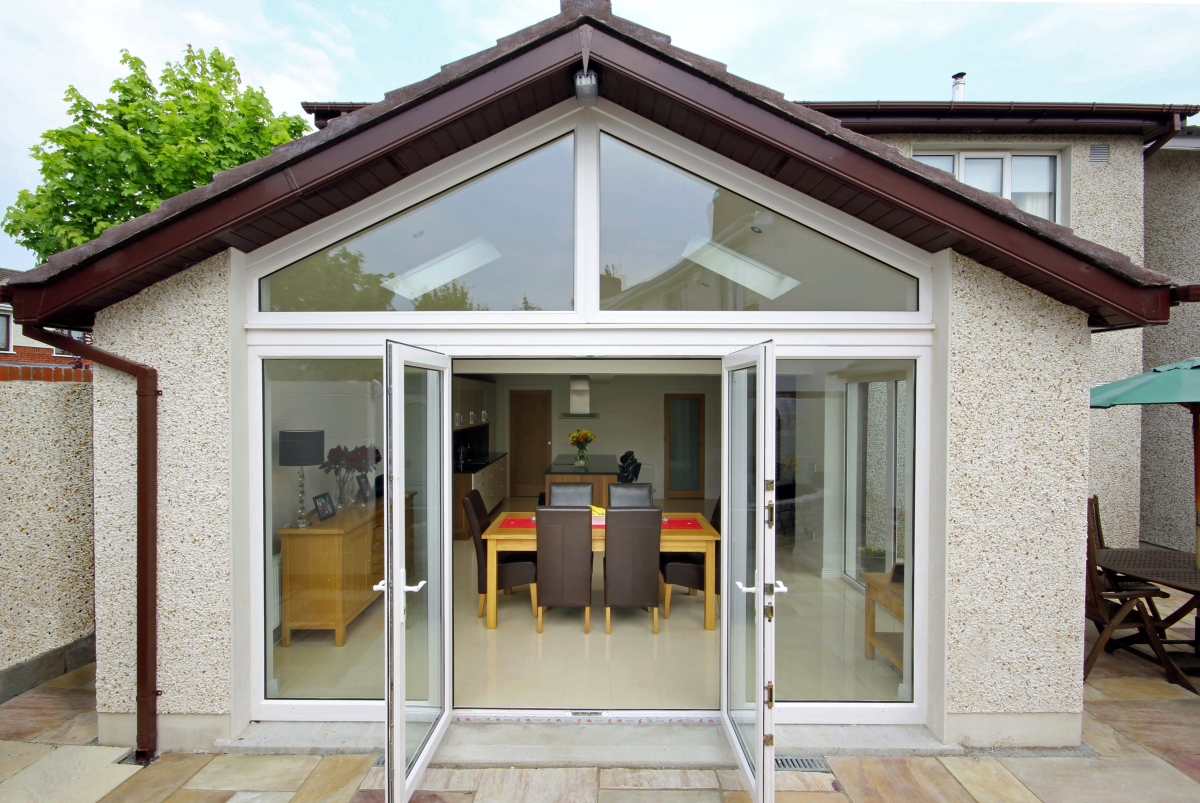 Image looking into extension through glass patio doors into living area from exterior garden