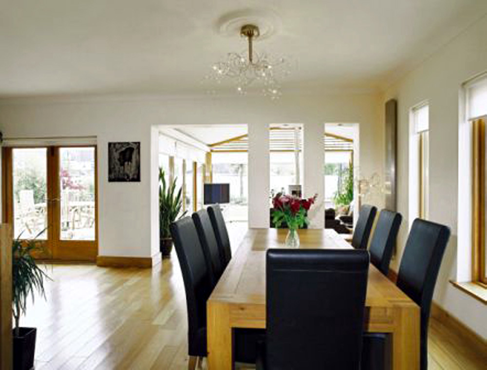 Interior image of new sunroom extension from dining room with garden views