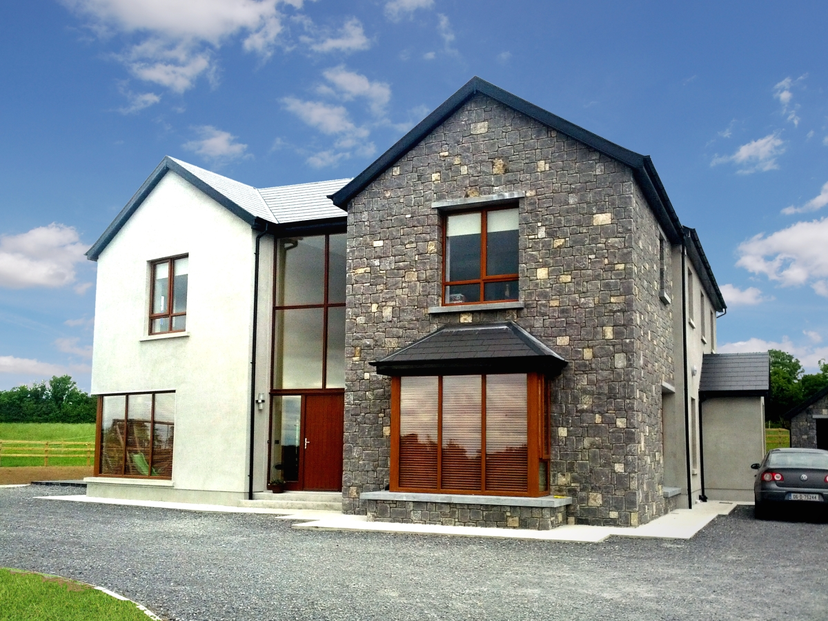 Exterior image of new build home in Westmeath with grey stone and white exterior