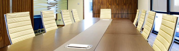 Interior image of boardroom with wood and cream accents