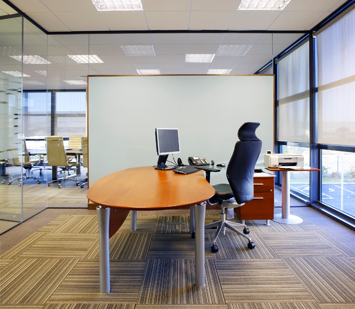 Interior image of individual office with glass partitions