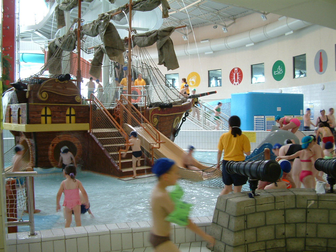 Children playing in the water and on the Pirate Ship