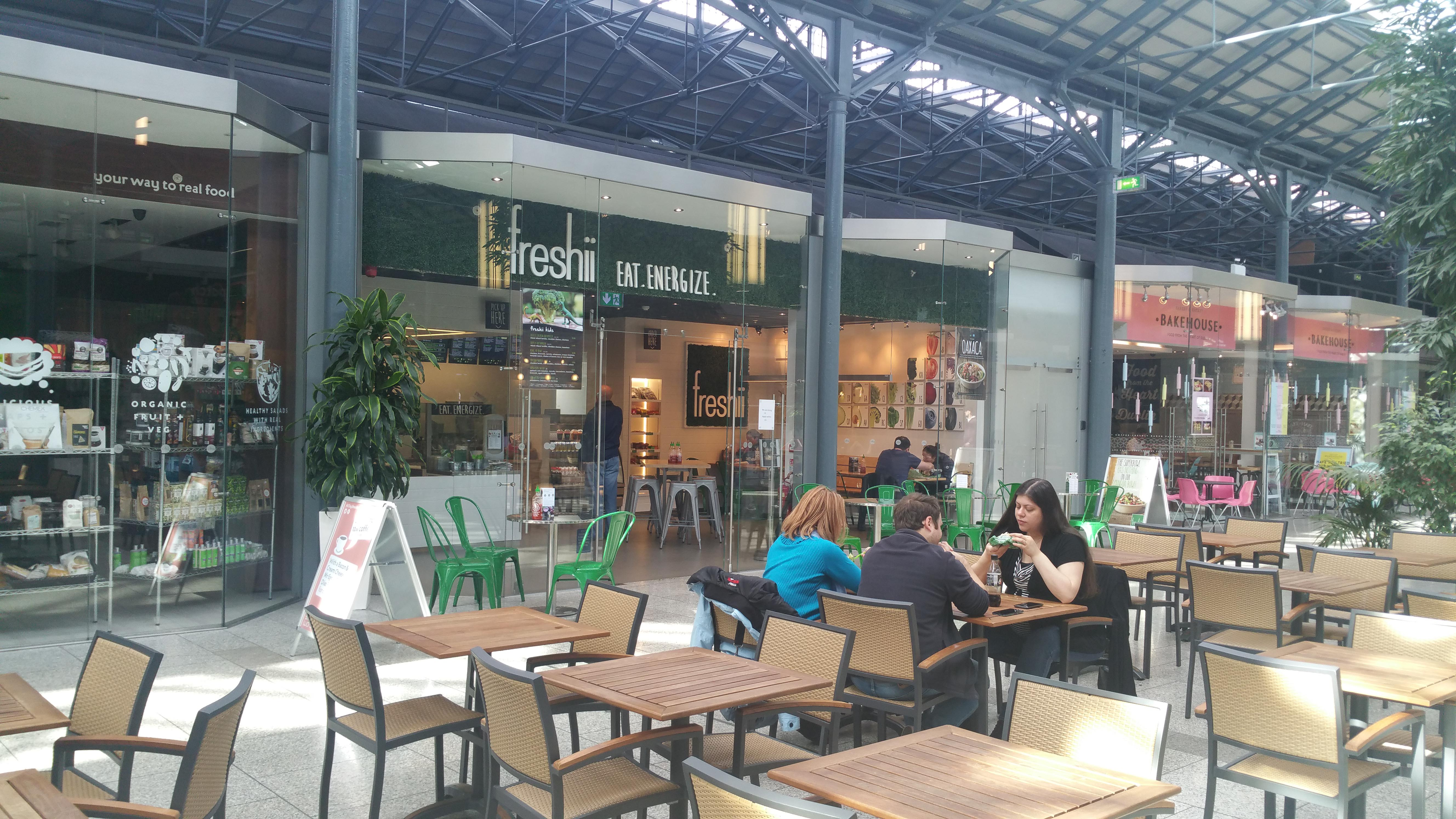 Outdoor seating area of Freshii CHQ