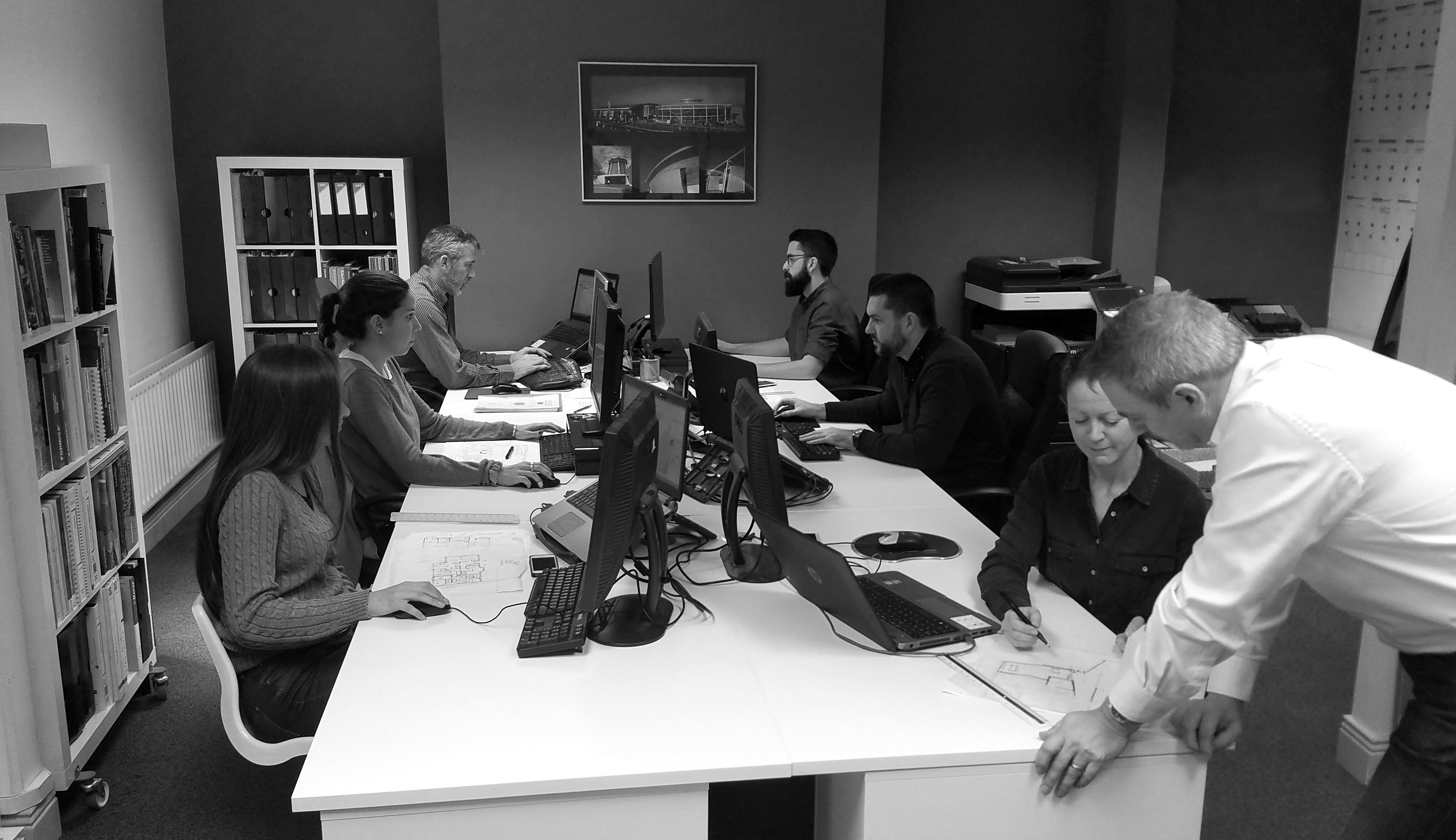 Black and white photo of staff working in office